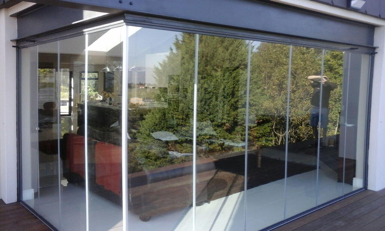 Frameless glass stacking doors in cape town weather for Sliding glass wall price